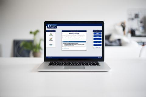 DukeHub website shown on a laptop